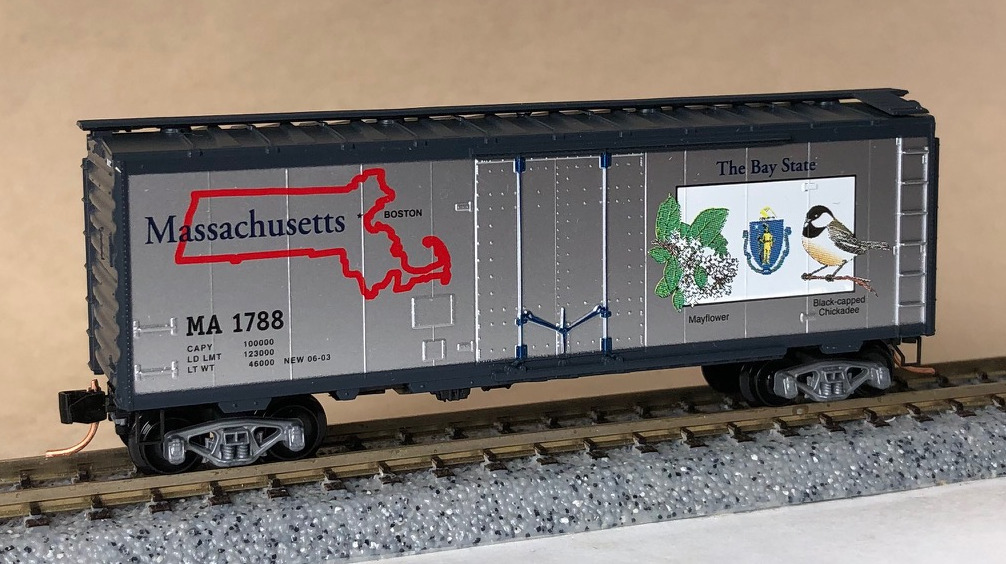 N Scale - Micro-Trains - NSE MTL 13-120 - Boxcar, 40 Foot, Steel Plug Door - Merry Christmas - 2013