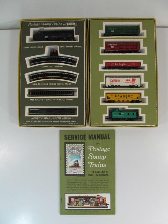 N Scale - Aurora Postage Stamp - 4715 - EMD F9 7-Unit Cannonball Freight Set - Penn Central - 7-Unit Set