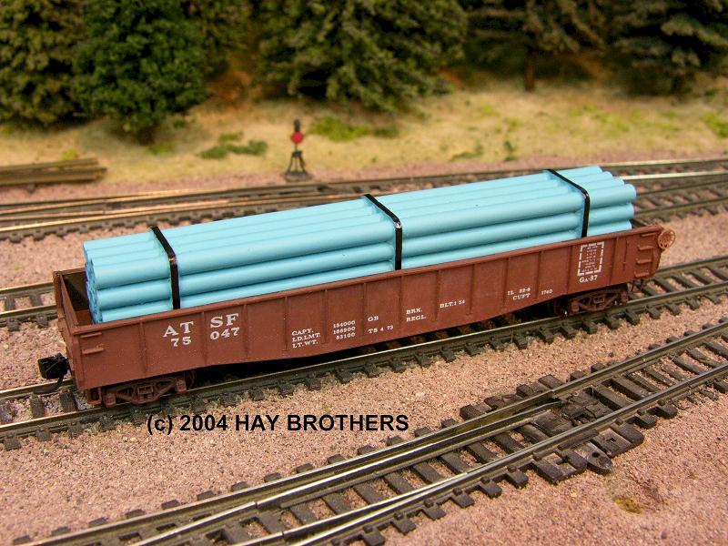 N Scale - Hay Bros - 2001-07B - Load - Painted/Unlettered - BANDED BLUE PIPE LOAD