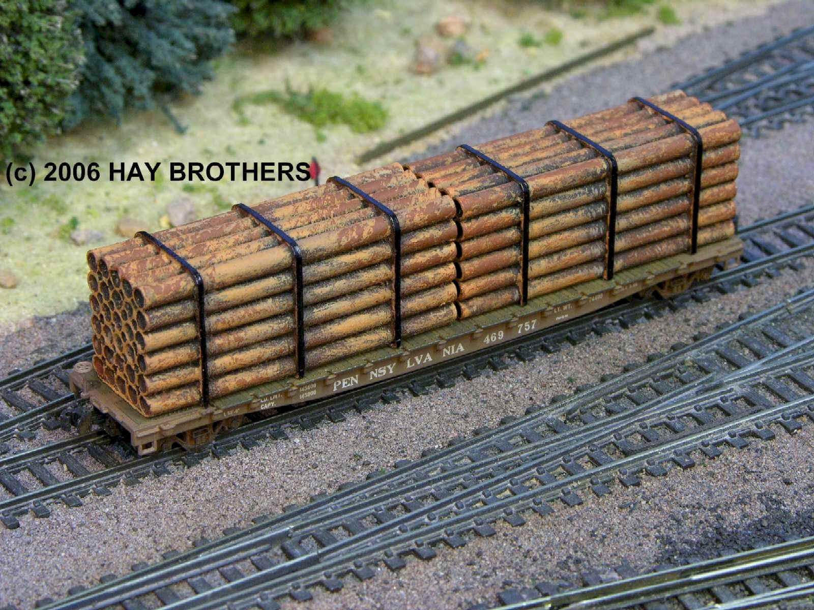 N Scale - Hay Bros - 2004-12 - Load - Painted/Unlettered - 24 FT RUSTY PIPE LOADS (2/PKG)