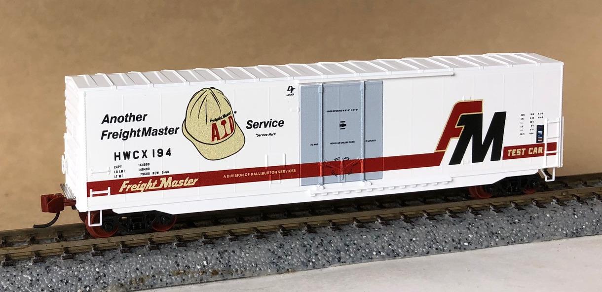 N Scale - Micro-Trains - NSE MTL 20-58 - Boxcar, 50 Foot, Steel, Plug Door - FreightMaster Industries - 194